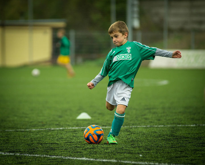 soccer boy shooting a ball