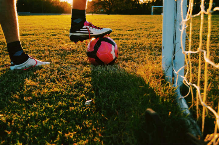 soccer shoes and ball on the field