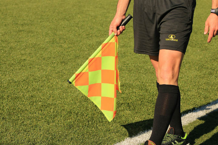 soccer assistant referee holding flag