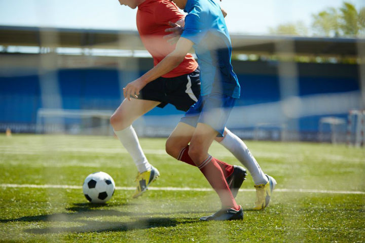 girl soccer tackle