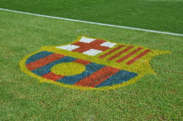 barcelona soccer emblem on grass