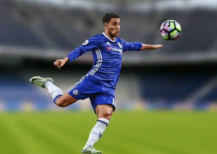 fc chelsea player in a blue jersey shooting a soccer ball