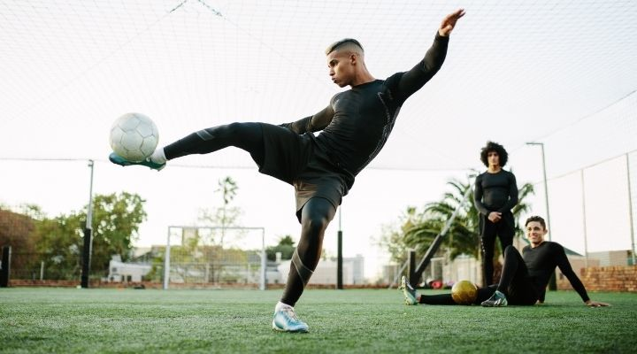 Soccer player showing off his skills during practice